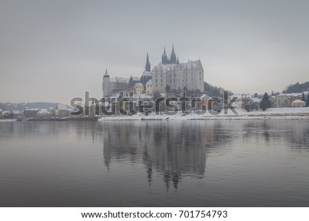 Meissen castle and cathedral with the river Elbe at winter