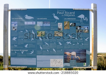 MEJANES, FRANCE - AUGUST 31: Signaling on the way Vaccar's Camargue explaining all species of migratory birds present in the Camargue, august 31, 2014.
