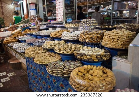 MEKNES, MOROCCO - JUL 28: Sweets stall at a market on Jul 28, 2010 in Meknes, Morocco. Meknes is a 1000 years old imperial city in Morocco. - stock photo
