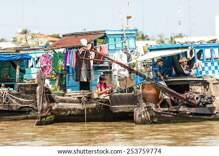 Mekong Delta, Vietnam-December 10, 2013. Life of local people in their houseboats on December 10, 2013 at Mekong Delta near to Cai Be Town in Vietnam. - stock photo