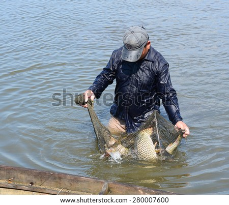 MEKONG DELTA, VIETNAM - MARCH 12, 2015: Unidentified fisherman fishing on small river in Dong Thap, southern Vietnam.