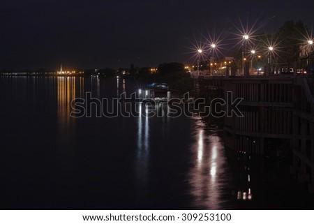 Mekong Riverside at night time at Nong Khai, Thailand - stock photo