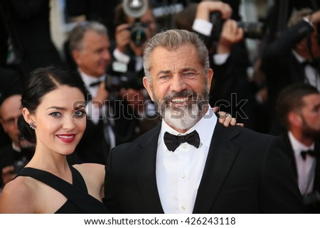 Mel Gibson  and Rossalind Ross  attend the Closing Ceremony of the 69th annual Cannes Film Festival at the Palais des Festivals on May 22, 2016 in Cannes, France. - stock photo