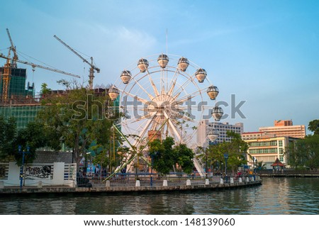 MELAKA, MALAYSIA - APRIL 15: Eye on Malaysia on April 15, 2013 in Melaka, Malaysia. It is was a transportable ferris wheel installation with an overall height of 60 metres.