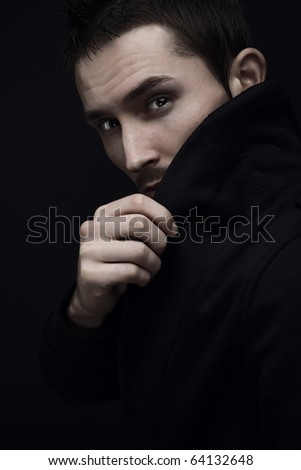 Melancholic guy on dark background.