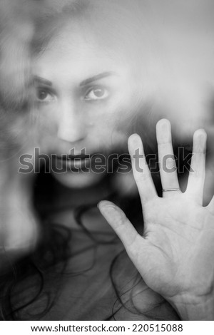 Melancholy reflection of the girl in the window - stock photo