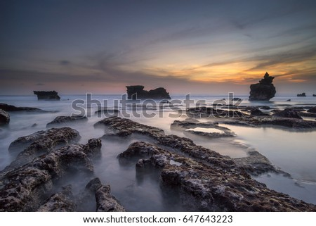 Melasti beach, Tanah Lot, Bali, Indonesia - May 11, 2017 : Just after sunset at rocky Melasti beach