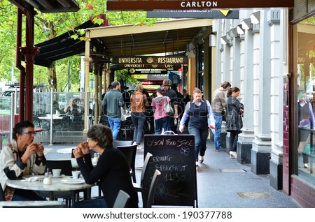 MELBOURNE - APR 10 2014:Dinners at restaurants in Lygon Street.Its a famous tourist attraction in Melbourne with Italian restaurants and cafes. - stock photo