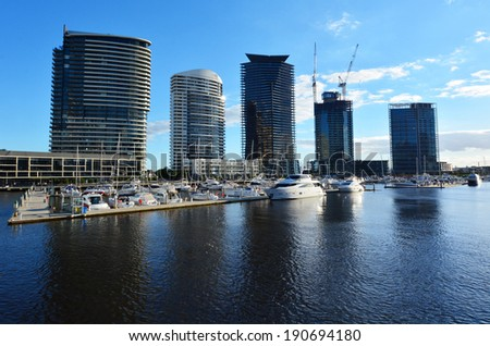 MELBOURNE - APR 14 2014:New buildings rises above the Yarra river in Docklands Melbourne, Victoria.The development of Melbourne Docklands is one of the largest urban renewal projects in Australia. - stock photo