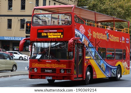 MELBOURNE - APR 11 2014:Visitors on Melbourne tour bus.It circle around the capital state of Victoria and the second most populous city in Australia show tourist the unique landmarks and history.