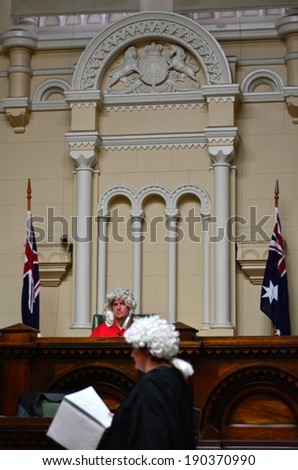 MELBOURNE - APR 11 2014:Visitors taking roles in the Trial of Ned Kelly at the Former Melbourne Magistrates Court.It was opened on 20 January 1914, and served the City for 81 years (1995). - stock photo