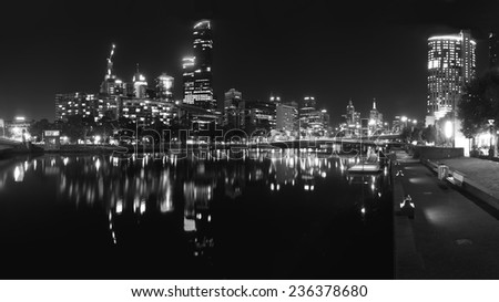 melbourne at night reflected in the yarra river - stock photo