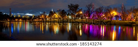 melbourne at night with colourful reflections in the yarra river - stock photo