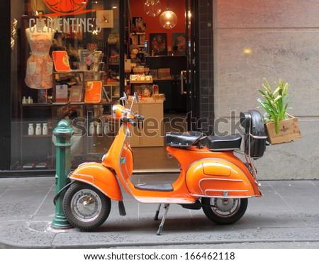 MELBOURNE - August 3: Orange Vespa parked on Degraves Street Melbourne downtown - August 3,2013 in Melbourne Australia.  - stock photo