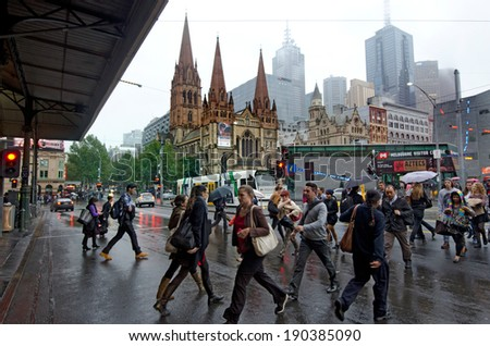 MELBOURNE, AUS - APR 10 2014:Traffic on Swanston Street and Federation Square.Melbourne have population and employment growth with international investment in the city's industries and property market - stock photo