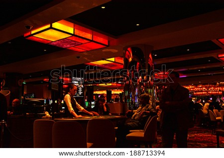 MELBOURNE, AUS - APR 11 2014:Visitors paly Blackjack at Crown Casino, Melbourne.It's the largest casino complex in the Southern Hemisphere and one of the largest in the world.