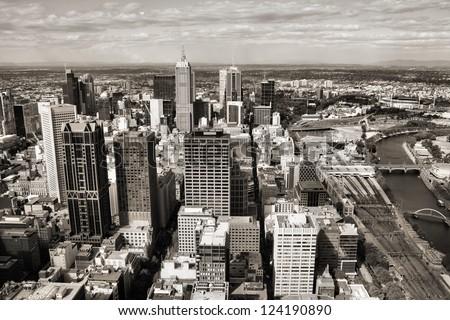 Melbourne, Australia. Aerial view of skyscraper city. Central business district (CBD). Sepia tone photo. - stock photo