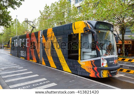 MELBOURNE AUSTRALIA - APRIL 6, 2016: Melbourne modern tram. Modern tram runs in Melbourne city center. Melbourne has the largest urban tramway network in the world. Melbourn, april 6, 2016 - stock photo