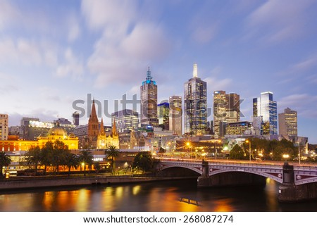 Melbourne, Australia - April 2, 2015: View of modern buildings in Melbourne CBD at sunset - stock photo