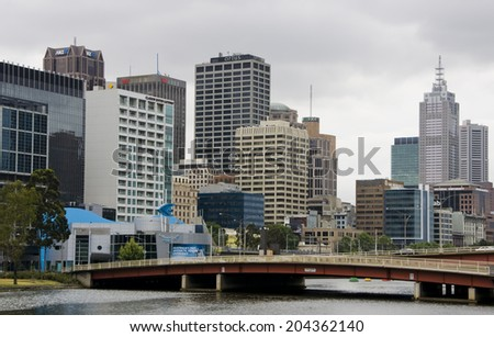MELBOURNE, AUSTRALIA - CIRCA NOVEMBER 2009: View on the high-rises of downtown Melbourne with bridge over the Yarra River in the front.