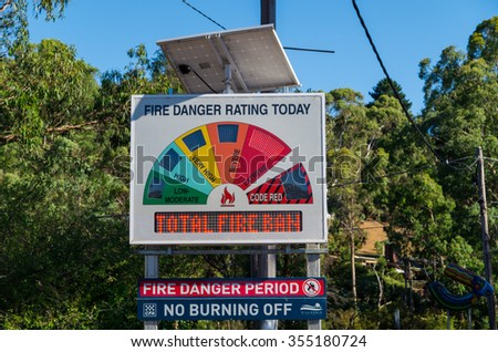 Melbourne, Australia - December 20, 2015: a Country Fire Authority sign warning of extreme fire danger and a total fire ban in the Melbourne northern fringe suburb of Warrandyte.