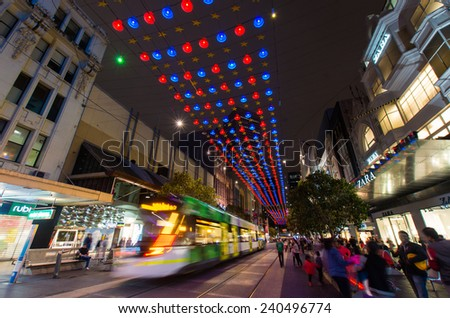 MELBOURNE, AUSTRALIA - December 23, 2014: Christmas lights and crowds in Bourke Street Mall, many lining up to view the famous Myer Christmas windows.  The Zara fashion store is on the right.