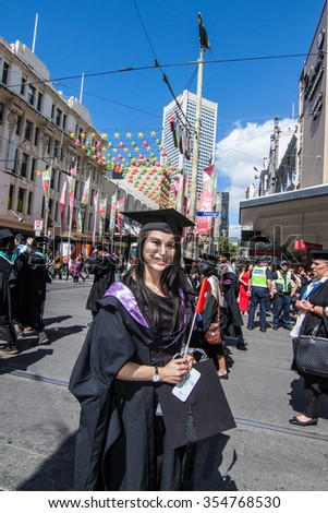 Melbourne, Australia - December 17, 2014 - RMIT university graduation day - the students walk along the Swanton St in Melbourne city for celebration day in graduation day