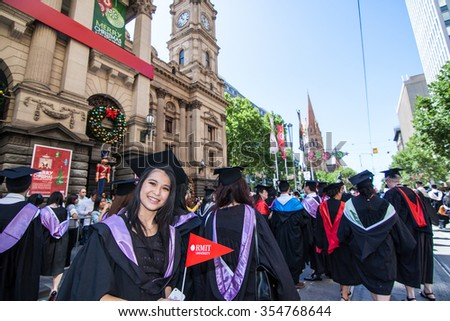 Melbourne, Australia - December 17, 2014 - RMIT university graduation day - the students walk along the Swanton St in Melbourne city for celebration day in graduation day - stock photo