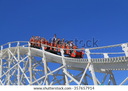 MELBOURNE AUSTRALIA - DECEMBER 29, 2015: Unidentified people visit Luna Park amusement park. St Kilda is home to many attractions such as Luna Park and St Kilda beach.  - stock photo