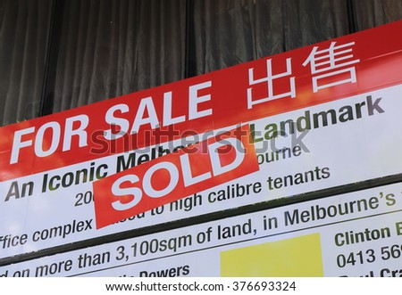 MELBOURNE AUSTRALIA - FEBRUARY 13, 2016: Real estate sold sign in downtown Melbourne.  - stock photo