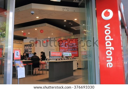 MELBOURNE AUSTRALIA - FEBRUARY 13, 2016:Unidentified people shop at Vodafone in Melbourne. Vodafone is the world's third-largest mobile telecommunications company.  - stock photo