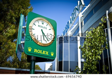 MELBOURNE, AUSTRALIA - JANUARY 22:  A Rolex clock next to the Rod Laver Arena which holds the center court at the Australian Open, January 22, 2011 in Melbourne, Australia - stock photo
