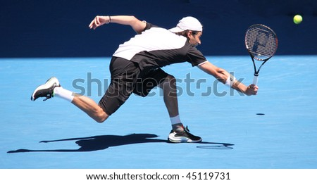 MELBOURNE, AUSTRALIA - JANUARY 23: Albert Montanes of Spain in his third round match against Roger Federer of Switzerland during the 2010 Australian Open  on January 23, 2010 in Melbourne, Australia - stock photo