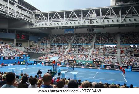 MELBOURNE, AUSTRALIA - JANUARY 20: ATP player Jo Wilfried Tsonga serves to Frederico Gil at Hisense Arena in the 2012 Australian Open, in Melbourne Australia on January 21, 2012. - stock photo