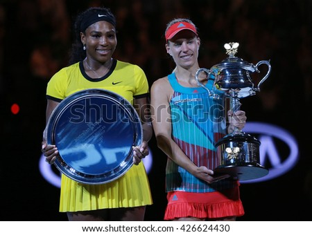 MELBOURNE, AUSTRALIA - JANUARY 30, 2016:Australian Open 2016 finalist Serena Williams (L) and Grand Slam champion Angelique Kerber of Germany during trophy presentation after final match in Melbourne  - stock photo