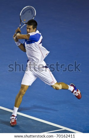 MELBOURNE, AUSTRALIA - JANUARY 30: Australian Open Men's Final, Novak Djokovic(SRB)[3] who defeated Andy Murray(GBR)[5]on January 30, 2011 in Melbourne, Australia - stock photo