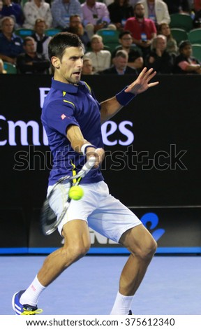 MELBOURNE, AUSTRALIA - JANUARY 31, 2016: Eleven times Grand Slam champion Novak Djokovic of Serbia in action during his Australian Open 2016 final match at Rod Laver Arena in Melbourne Park - stock photo