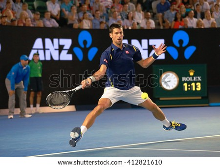 MELBOURNE, AUSTRALIA - JANUARY 26 2016: Eleven times Grand Slam champion Novak Djokovic of Serbia in action during his Australian Open 2016 quarterfinal match at Rod Laver Arena in Melbourne Park - stock photo