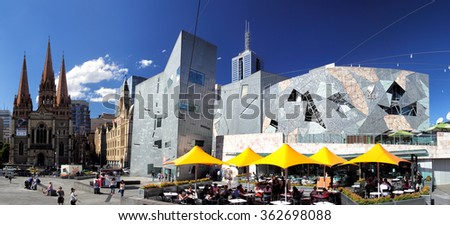 MELBOURNE, AUSTRALIA - JANUARY 16, 2015: Federation Square and St. Paul's Cathedral in downtown Melbourne on January 16, 2015. Its a popular place for tourists and local people - stock photo
