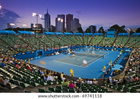 MELBOURNE, AUSTRALIA - JANUARY 22: Late night tennis in the Margaret Court Arena next to Rod Laver Arena which holds the center court at the Australian Open, January 22, 2011 in Melbourne, Australia - stock photo