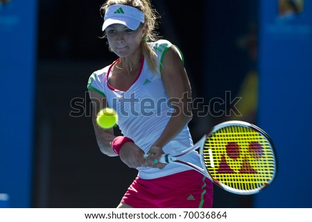 MELBOURNE, AUSTRALIA - JANUARY 28: Maria Kirilenko(RUS)[12] in the women's doubles final at the Australian Open on January 28, 2011 in Melbourne, Australia - stock photo