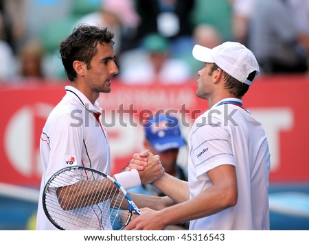 MELBOURNE, AUSTRALIA - JANUARY 26: Marin Cilic (L) of Croatia celebrates his quarter final win over Andy Roddick during the 2010 Australian Open on January 26, 2010 in Melbourne, Australia - stock photo