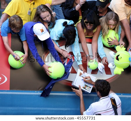 MELBOURNE, AUSTRALIA - JANUARY 26: Marin Cilic of Croatia signs autographs after his quarter final win over Andy Roddick during the 2010 Australian Open on January 26, 2010 in Melbourne, Australia - stock photo