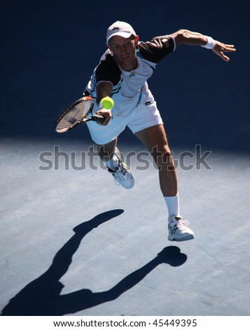 MELBOURNE, AUSTRALIA - JANUARY 27: Nikolay Davydenko in action at his quarter final loss to Roger Federer during the 2010 Australian Open on January 27, 2010 in Melbourne, Australia - stock photo