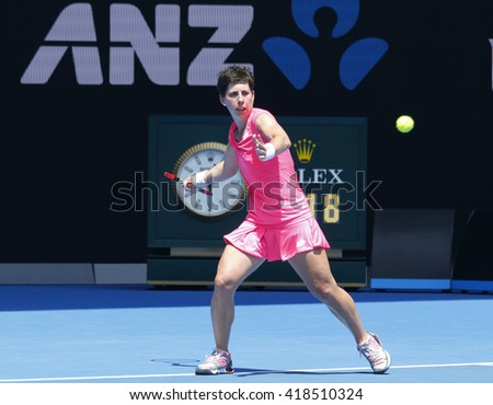 MELBOURNE, AUSTRALIA - JANUARY 26, 2016: Professional tennis player Carla Suarez Navarro of Spain in action during her quarterfinal match at Australian Open 2016 in Melbourne Park - stock photo