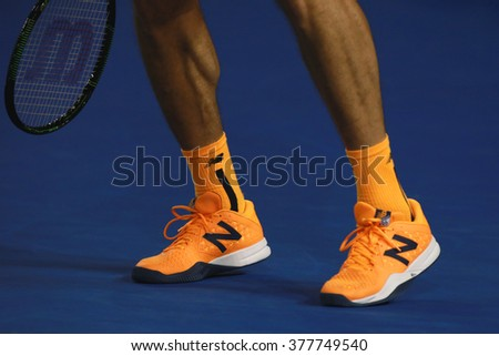 MELBOURNE, AUSTRALIA - JANUARY 29, 2016: Professional tennis player Milos Raonic of Canada wears custom New Balance tennis shoes during Australian Open 2016 semifinal match at Rod Laver Arena  - stock photo