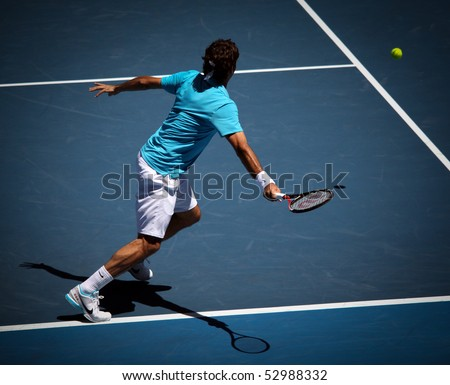 MELBOURNE, AUSTRALIA - JANUARY 27: Roger Federer in action at his win over Nikolay Davydenko during a quarter final match in the 2010 Australian Open on January 27, 2010 in Melbourne, Australia - stock photo