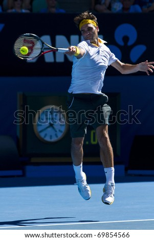 MELBOURNE, AUSTRALIA - JANUARY 23: Roger Federer(SUI)[2] defeats Tommy Robredo(ESP) at the Australian Open on January 23, 2011 in Melbourne, Australia - stock photo