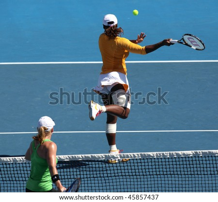 MELBOURNE, AUSTRALIA - JANUARY 26: Serena Williams evades a volley from Bethanie Mattek Sands a doubles match during the Australian Open on January 26, 2010 in Melbourne
