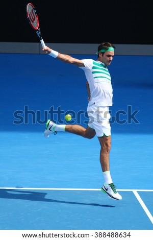 MELBOURNE, AUSTRALIA - JANUARY 26, 2016: Seventeen times Grand Slam champion Roger Federer of Switzerland in action during quarterfinal match at Australian Open 2016 in Melbourne Park - stock photo